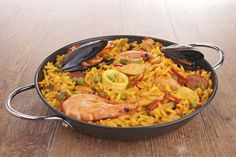 National Dishes Around the World /Paella is Spanish rice dish that originated in the fields of a on the eastern coast of Spain. Today paella is made in every region of Spain, using just about any kind of ingredient that goes well w/ rice. There're as many versions of paella as there are cooks. It may contain chicken, pork, shellfish, fish, eel, squid, beans, peas, artichokes, or peppers. Saffron, the spice that also turns the rice into a wonderful golden color, is an essential part of the…