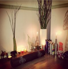 This simple set-up of candles and plants: