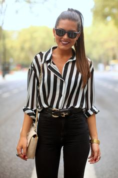 stripes and high waisted pants... and, she looks like she could break up a 'hockey fight'  :)