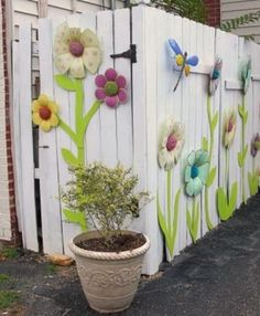 Adorable art on the fence, not sure how the neighbor would feel about my using his fence on cottage side, but this looks like fun