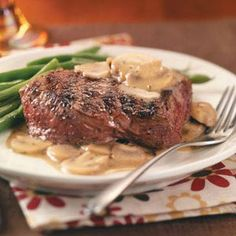 Grilled Steaks with Mushroom Sauce Recipe -Midweek days deserve something special. This steak entree with its savory sauce will fit the bill beautifully. —Taste of Home Test Kitchen
