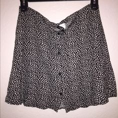 Daisy black skirt Lovely black skater/A line skirt. Has never been worn before and in great condition. Has a cute daisy pattern. No zippers, but buttons all along the front. Offers welcome! H&M Skirts
