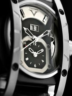 Sport GMT. Dial: Shaped with apertures revealing the movement, black colour. Applied second time zone scale moulding and sector with logo at 12 o'clock, with black coating. Large date at 12 o'clock with applied frame. Day/night indicator uses 24-hour AM/PM system