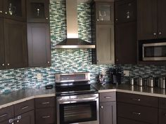 Check out this beauty, Bella Glass Tiles Rushing River Impression Series. This cool 1 x 3 glass tile mosaic is awesome Mosaic Glass, Kitchen Cabinets, Natural Stone Backsplash, Kitchen, Kitchen Backsplash Inspiration, Mosaic Tiles, Stone Tile Backsplash, Kitchen Tiles Backsplash, Backsplash Designs