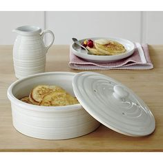 Farmhouse White Pancake Warmer in Specialty Serveware | Crate and Barrel - Love this set! There's a spouted mixing bowl, too!