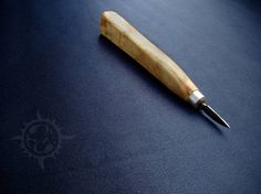 Small knife for wood carving. The knife is made of T1 steel.