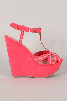 Coral peep-toe t-strap wedges with rhinestones.