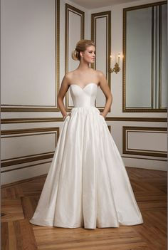 Justin Alexander - Jetta. An elegant Silk Dupion ball gown with piped neckline and waistline, full gathered skirt and pockets create simplicity at its best.