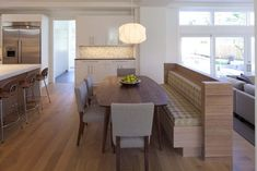 BENCH SEPARATING KITCHEN AND FAMILY ROOM. Kitchen - contemporary - kitchen - minneapolis - Charlie Simmons - Charlie & Co. Design, Ltd.