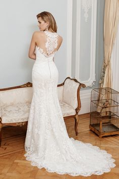 This fit & flare style features lace trim, halter neckline & illusion tulle back for a seriously elegant, romantic wedding dress. Stunning Wedding Dresses, Designer Wedding Dresses, Bridal Lace, Bridal Gowns, Glamorous Wedding Inspiration, Wedding Dress Outlet, True Bride, Jewel Tone Wedding, Romantic Weddings