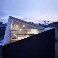 I love the mixture of roof angles, and the large windows with their lovely black…