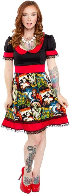 PAPERDOLL MONSTERS DRINK DRESS All of your favorite monsters are back on the Paperdoll Drink dress! This ghoulishly girly little doll baby dress features a scooped peter pan collar into monster patterned full skirted bottom all trimmed in red fabric & black lace. $82.00