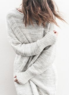 Kaitlyn Ham is wearing an oversized knit jumper from Acne Studios
