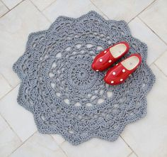 Crocheted doily rug with wooden shoes
