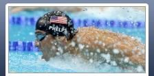 301b: This photo is of American swimmer, Micheal Phelps during a competition. You can easily tell who he is and where he is from by looking at the side of the swim cap. He looks very powerful as if he is bursting out of the water. The water droplets around him emphasize his speed. It is surprising that an American news organization did not feature its country's star athlete as the primary photo on the site.