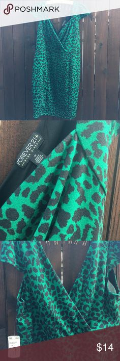 Forever 21 size 1x new with tags leopard dress New dress from forever 21 size 1x green leopard print see picture for details! Very cute and pretty color Forever 21 Dresses Midi