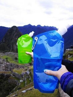 Folding Water Bag is space efficient and it has a 20 OZ. capacity, making it an ideal product for backpacking. Camping Chairs, Outdoor Camping, Easy To Use, How To Make, Beach Ball, Brand It, Fun Drinks, Drinkware, Health And Wellness