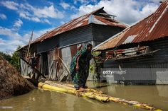 A woman trying to find out the damage of her house to due to flood water at Jamalpur, Bangladesh. Jamalpur is a northern district of…