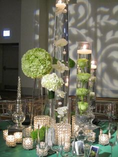 Who says every table has to have the same exact style, times 25?! Think variations, textures and different elements. Collection of mercury glass, mixed with rhinestone votives, acrylic cubes and floating candles.  -StemLine Creative