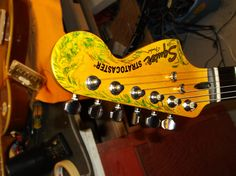Squier headstock with 'vine-and-flower' artwork....