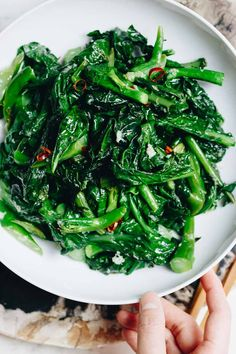 Healthy leafy greens - Chinese Broccoli with Garlic Sauce! Easy Chinese Broccoli stir fry (kai lan) with garlicky sauce is Vegan, Paleo, Keto, and low carb. A great way to add dark leafy greens to your meal. Chinese Broccoli Recipe, Asian Broccoli, Broccoli Recipes, Broccoli Greens Recipe, Shrimp Recipes, Easy Vegetable Stir Fry, Vegetable Side Dishes, Vegetable Recipes, Whole30 Dinner Recipes
