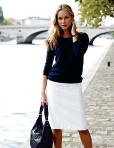 understated A-line skirt embellished with nothing more than pretty, parallel lines of stitching