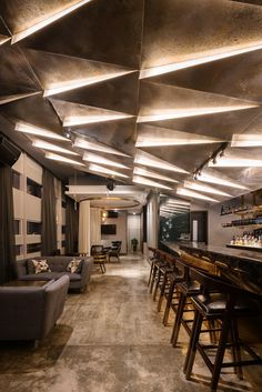 © Seth Powers. COSMO - a four story sales center for a residential complex in Chengdu, China. Designed by Ian Douglas-Jones of Atelier I-N-D-J. The bar and the lounge areas.