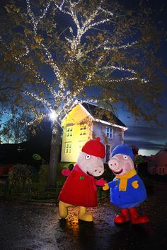 Peppa and George outside Peppa's House in Peppa Pig World at Christmas time https://paultonspark.co.uk/attractions/christmas-wonderland-peppapigworld/