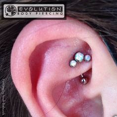 Fresh #rook piercing with #opal and #titanium jewelry by #anatometal (at Evolution Piercing)