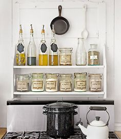Same size jars, vintage labels, functional storage. Love the cast iron skillet hung from the top. Overall clean and simplistic.