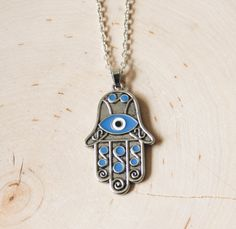 Hey, I found this really awesome Etsy listing at https://www.etsy.com/listing/246385223/hamsa-evil-eye-pendant-necklace-silver