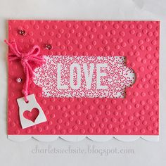 Card using an embossing folder with a window die cut and stamped image showing through the window.