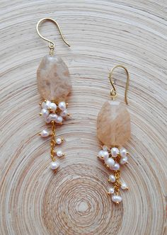 With their effortless elegance and easy-to-wear style, Champagne long cluster earrings are an absolute must-have for any collection. I wire wrapped using gold filled wire a gorgeous rutillated quartz faceted flat nugget bead that is connected with a 14 K gold vermeil chain. A lush