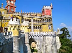 If you're planning a trip to #Lisbon, consider taking a day trip to Sintra where you'll find the sun kissed Pena National Palace on a hilltop among lush forests.