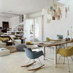 We are in love with this Living area! What do you think?  Zettel'z 5 Lamp by Ingo Maurer - Eames Eiffel Rocking Chair  by  Charles and Ray Eames - Pietra Mediterranea Collection by Casa dolce casa @florim_ceramiche  #designbest #livinginspiration #rocking