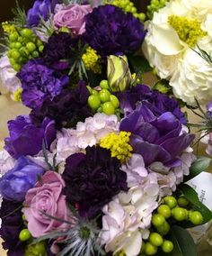 Purple wedding flowers  www.myfloweraffair.net