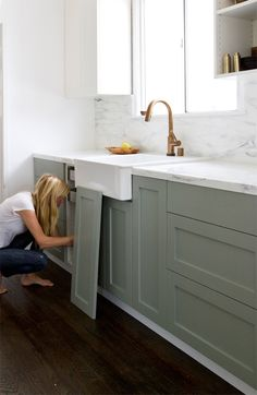 Ikea Upgrade: The SemiHandmade Kitchen Remodel - Remodelista pigeon by farrow & ball - purty! Also, there's a cool link to a company that makes custom cabinet fronts that fit onto IKEA cabinets here. Ikea Hack Kitchen, Ikea Kitchen Cabinets, Kitchen Cabinet Colors, Painting Kitchen Cabinets, Kitchen Paint, Kitchen Dining, Kitchen Decor, Kitchen Ideas, Gray Cabinets