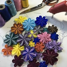 More and more Kanzashi! #wip #fabricflowers by cgrabskidesigns