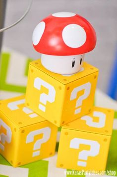 Mario Themed Birthday Party -- Love the boxes. They'd make great gift boxes. Could probably make these out of yellow paper using a template.