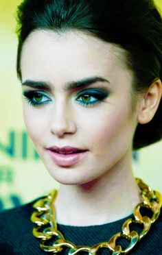 Emerald green eye make up. Hazel green eyes. heavy but sheer matte clear cheeks. Lily Collins ♥