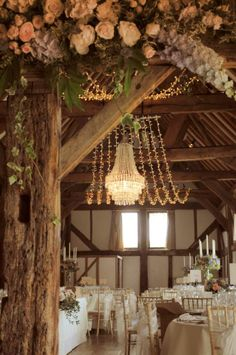Our most pinned install - crystal chandelier and fairy light canopy for a stunning barn wedding. By Oakwood Events.