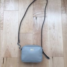 🆕 🎉 2x HP🎉 Michael Kors Grey mini Crossbody Super cute! Pearl grey with silver hardware. Crossbody. Leather. 4 Credit card slots inside plus 1 side compartment. No trades. 6.5 x 5 x 1.5 inches. MICHAEL Michael Kors Bags Crossbody Bags
