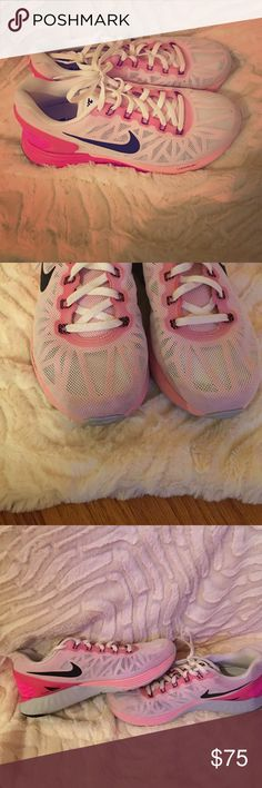 Nike pink and white lunarglide 6 Worn only a couple times. They are a size 8 and I'm a 7.5. These are slightly big on me. Nike lunarglide 6. Nike Shoes Athletic Shoes