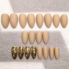 *Nude Matte Fake Nails * Gold Glitter Accent Nails * Faux Nails * Glue On Nails * Round Tip Stiletto * Matte Nails * Glitter Nails*  Your order will come with 20 faux nails. 10 pairs in 10 sizes ranging from 0-9 to ensure that you will find a perfect match. It will also include instructions. Nail glue and adhesive tabs ARE NOT included. If you use nail glue, the nails are only good to use once. If you use adhesive tabs and take good care of the nails, you can use the nails multiple times…