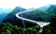 Some Amazing Facts  Amazing Pedestrian Bridge...!!!!  (~ Credits: Did You Know?.. )    This curved pedestrian bridge is 2000 feet above sea level at the top of Mount Mat Cincang in Malaysia. Set above the treetops, 400-foot long Langkawi Sky Bridge is one of the highest elevated single-stay bridges in the world. The deck is less than 6 feet wide and its curved shape gives travelers a panoramic view of Langkawi, an archipelago of 99 islands..