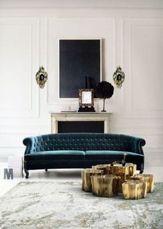 Beautiful velvet sofa anchored by dark painting