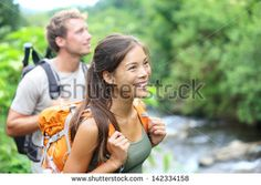 People Hiking - Happy Hiker Couple Trekking As Part Of Healthy Lifestyle Outdoors Activity. Young Multiracial Couple Walking In Nature In Iao Valley State ...