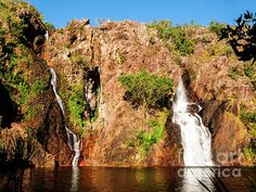 Wangi Waterfalls, Litchfield National Park.The Northern Territory epitomises RAW Australia everyone loves. Two UNESCO sites. Kakadu-Uluru. Awe inspiring rock formations, gorges, ranges, deserts, crocodiles, billabongs, rock art, ancient civilisation. Remote long distances. An artists & photographers delight. Visit my photo gallery and get a beautiful Fine Art Print, Canvas Print, Metal or Acrylic Print. 30 days money back guarantee on every purchase so bring some 'NATURE' in your home or…