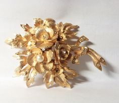 Large gold tone floral brooch/pin with pearls and by SpaceDucky