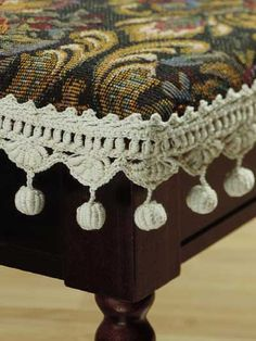 """Ball Fringe Stool Edging - Add an old-fashioned touch to home furnishings with this pretty roll-stitch fringed edging. It's worked with size 10 thread & size 7 steel hook. 1-1/2"""" deep, not including ball fringe.  Skill level: Intermediate  Designed by Maggie Petsch  free pdf from freepatterns.com"""